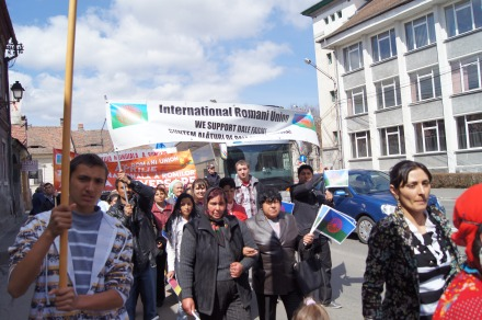 Roma Activists in Romania hold a banner saying 'We Support Dale Farm' as part of Roma Nation Day.